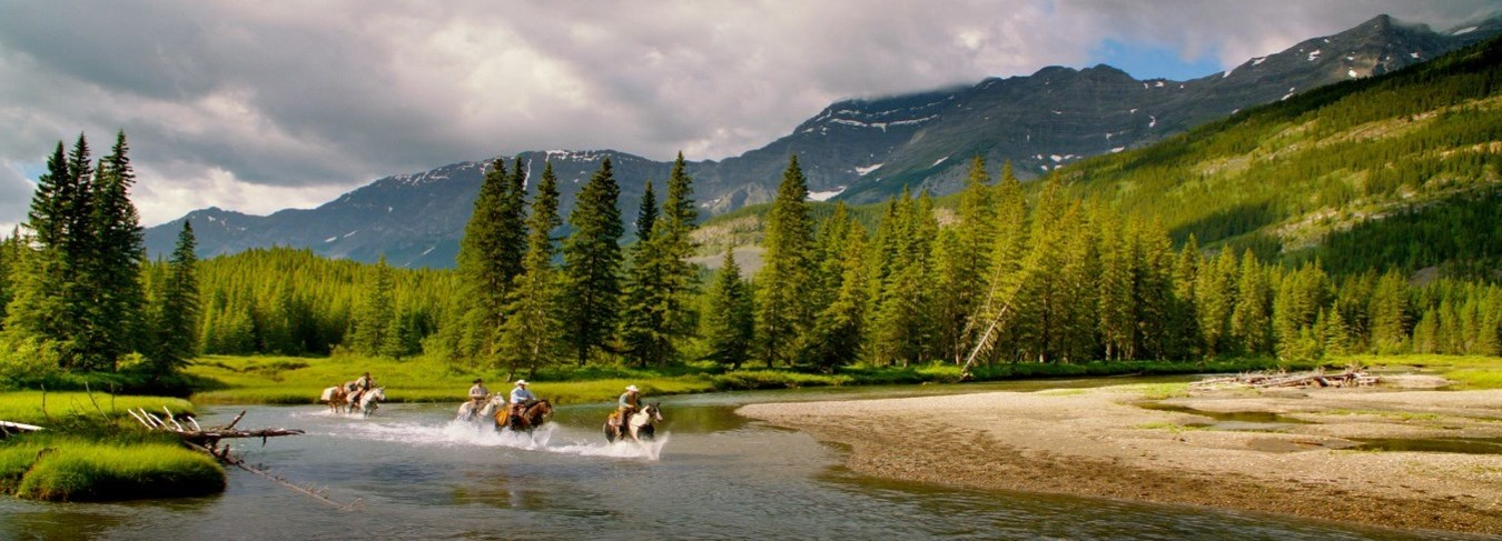 AB, Kananaskis Country riders in river, credit Travel Alberta, Sean Thonson